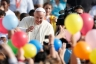 Pope Francis is pictured through balloons as he arrives to lead his general audience in St. Peter's Square at the Vatican Oct. 30. CNS photo/Paul Haring