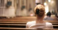 a-woman-sits-in-CHURCH